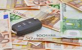 Car keys over euro banknotes — Stock Photo