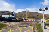 Traffic signs and barriers Level Crossing Road — Stock Photo