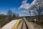 Narrow Gauge Train stopped at station or stopping place on the field. — Stock Photo