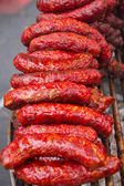 Sausages on grill — Stock Photo