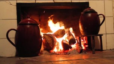 Chimney pots on the fire — Stock Video