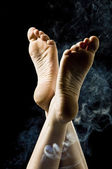 Feet surrounded by smoke — Stock Photo