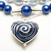 Close up of metal heart pendant — Stock Photo