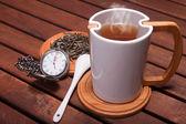 Tazza di tè e orologio — Stock Photo