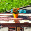 Antique table with flowers — Stock Photo