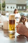 Light-dark beer on the bar — Stok fotoğraf
