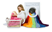 Young girl and washing machine with colorful things to wash, iso — Stock Photo