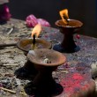 Sacred fire, candles in a buddhist temple - Stock Photo