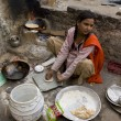INDIJAIPUR - MARCH 02: Unidentified indipoor girl cooking c — Stock Photo #26978469