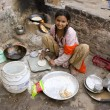 JAIPUR, INDIA - MARCH 02: Unidentified indian poor girl cooking — Stock Photo #26981847