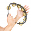Hands with a tambourine (hands play the tambourine) — Stock Photo