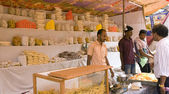 GOKARNA,INDIA - MAR 11: Unidentified man sells a sweet food in G — Stock Photo