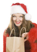 Beautiful mid adult woman in Christmas Santa Claus red hat with — Stockfoto