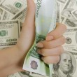 Hand holding a hundred euro, a lot of money (U.S. dollars) — Stock Photo