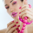 Beautiful girl with bright pink make-up and accessory close up — Stock Photo #38664743