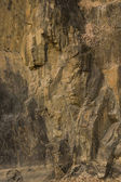 Dark brown rock texture. Stone background — Stock Photo