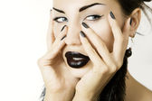 Beautiful girl with black lipstick matte black manicure and acce — Stock Photo