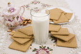 Glass of buttermilk (milk) and cookies  — Stock Photo