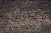 Old brick wall: Texture of dark vintage brickwork — Stock Photo