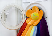 Washing machine, toy and colorful laundry to wash — Stock Photo