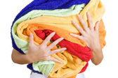 Woman holding a lot of colorful laundry in her hands, Isolated o — Stock Photo