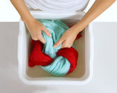 Hand washing of color laundry  — Stock Photo