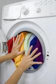 Woman loading laundry in the washing machine — Stock Photo