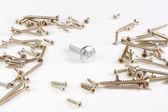 Srebrne śruby metalowe otoczony przez wiele technologii śruby. — Zdjęcie stockowe