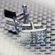 Pair of silver cuff links on the man's tie — Stock Photo #23207898