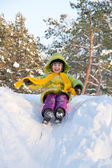 Happy kid on sled — Stock Photo