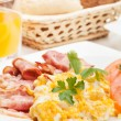 Scrambled eggs with bacon — Stock Photo #23173332