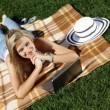 Woman with laptop in park — Stock Photo #23297424