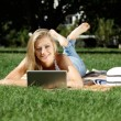 Woman with laptop in park — Stock Photo #23297534