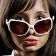 Portrait of a beautiful sexy girl with sunglasses — Stok fotoğraf