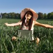 Stock Photo: Young woman working with a laptop outdoor