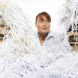 Young woman with shredded paper - Stockfoto
