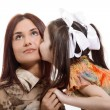 Daughter kisses her mother — Stock Photo