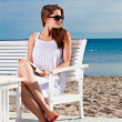 Pretty young woman relaxing on the beach - Stock Photo