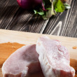 Raw pork chop on chopping board — Stock Photo