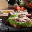 Sandwiches with cheese, ham and lettuce — Stock Photo