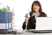 Businesswoman with telephone and smiling — Stock Photo