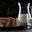 Sandwich and pitcher of milk - Stock Photo