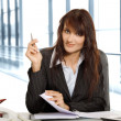 Young woman iin the office - Stock Photo
