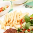 French fries, salad and chop - Stock Photo