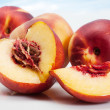 Peaches on abstract background - Stock Photo