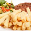 Stock Photo: French fries and salad