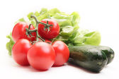 Fresh tomatoes, cucumber and lettuce — Stock Photo