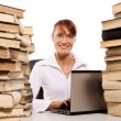 Beautiful young woman with stack of books on white background — Stock Photo