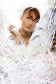Young woman with shredded paper — Stockfoto
