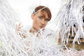 Young woman with shredded paper — Stock Photo